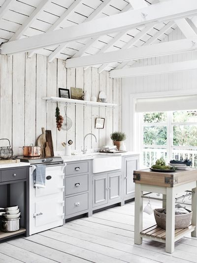 Light and airy country kitchen in white and soft grey.