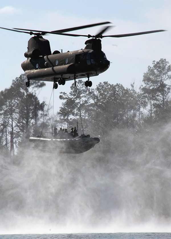 RHIB (Rigid Hull Inflatable Boat) as it is lifted by a CH-47d Chinook