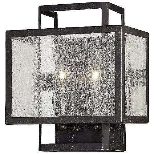 Urban elegance is achieved with clean design and traditional finishes. The Minka-Lavery Camden Square Clear Wall Sconce exemplifies transitional simplicity with strong lines in rich Aged Charcoal and delicate Clear Seeded glass. The nested rectangular frame offers a sense of symmetry and balance and its versatile styling can blend in or stand out depending on the design scheme at large.