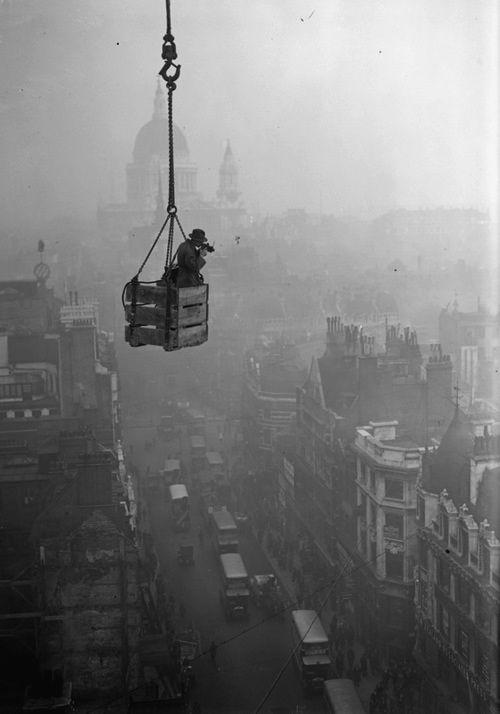Fleet Street London 1929  Photo: Fox Photos - gives me butterflies just looking at how high he is!