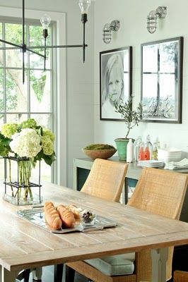 Gorgeous coastal dining room. Love the woven chairs, pale seafoam green wall