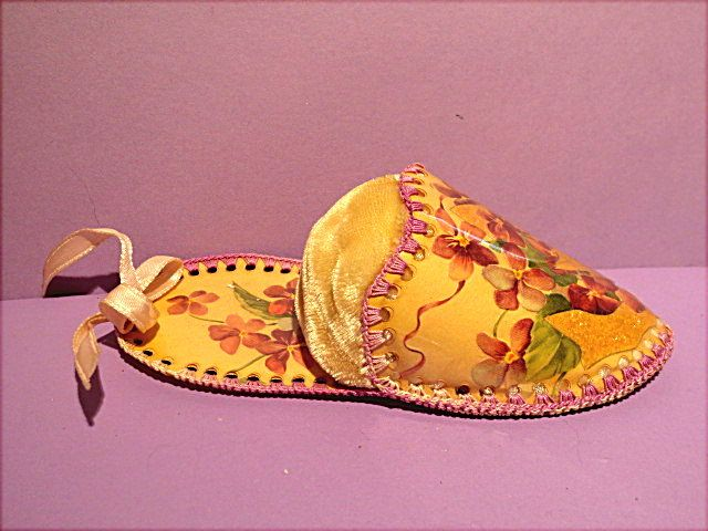 """Slipper Pincushion is made from plastic covered laced cards with a velvet inserted cushion.  Beautiful!  Lilacs.  Price $9.99.  Sold on website http://barbspencerdolls.com in Vintage and Gift Items.  5-1/2"""" long x 2-3/8"""" wide."""