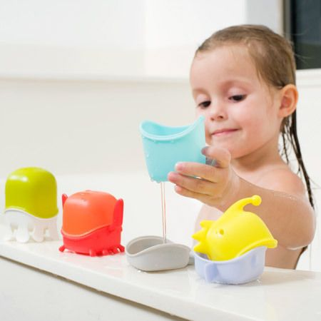 http://www.ruggabub.com.au/bath-time/boon-creature-cups-interchangeable-bath-toy/ Make lots of funny fish with boon bath creatures. Pull them apart, fill them with water and tip it out again. Small holes for dribbling water out, too. Mix and match to make lots of great bath creatures.