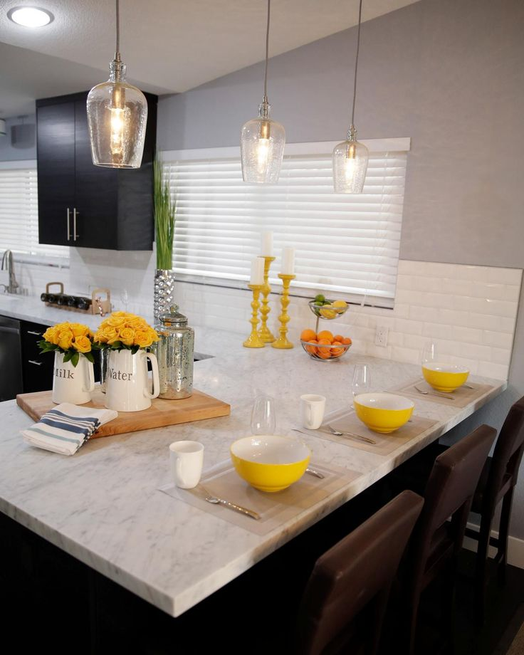 As seen on Brother Vs. Brother...A Carrara marble breakfast bar adds extra seating in Drew's kitchen. #BroVsBro
