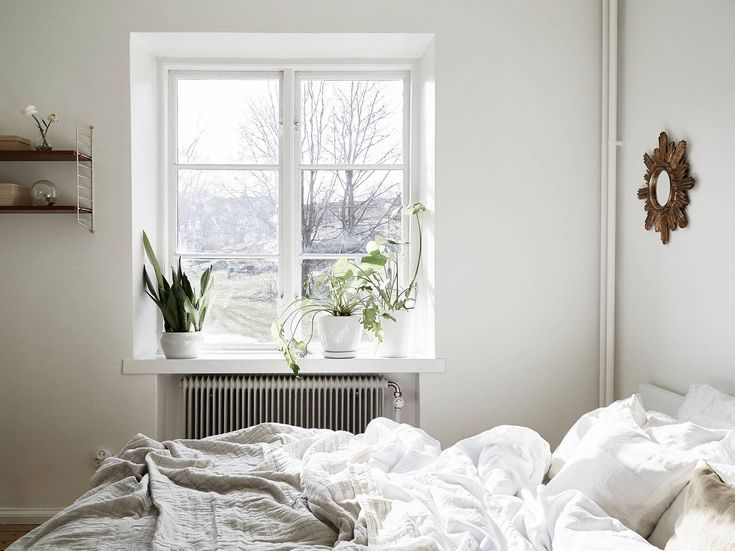 white bedroom with linen sheets