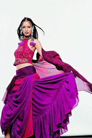 Purple frills  http://2.bp.blogspot.com/_im3BnqbvsfQ/TDrFwbisJYI/AAAAAAAAJYw/NKHvcGfKGh0/s640/india%2Bfashion%2Bweek.jpg