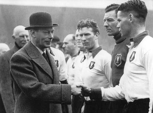 King George shakes hands with Billy Liddell at Wembley in 1950