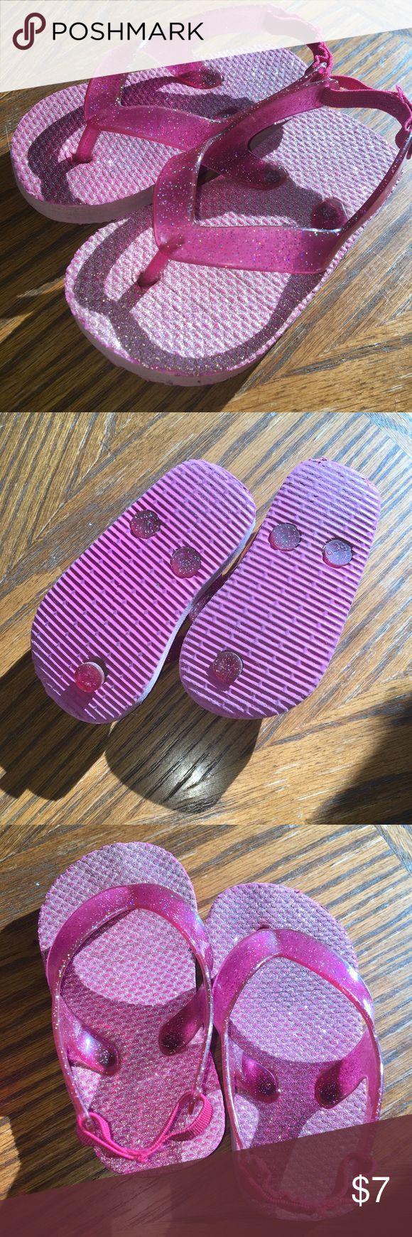 Pink Sparkly Flip Flips Pink Sparkly Flip Flips • Elastic sling back • Plastic thong piece • Foam sole • Still GOOD CONDITION! Shoes Sandals & Flip Flops