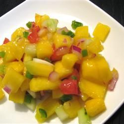 """This is a very tasty mango salsa that is great served over fish. My favorite is any fish blackened with Cajun seasoning and then topped with this salsa. Also great for dipping chips."""