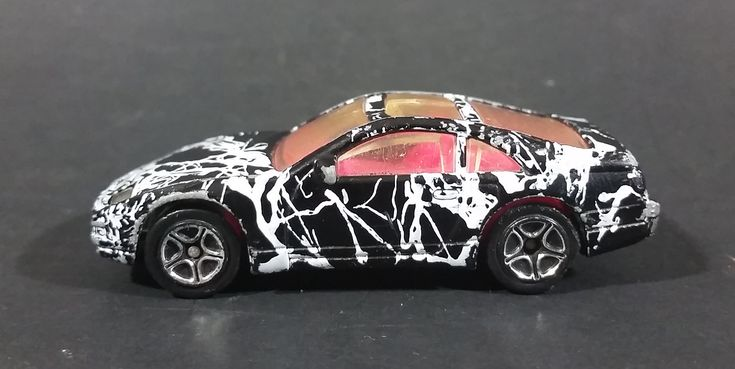 1996 Matchbox 1990 Nissan 300zx Black MB61 or MB37 Die Cast Toy Car Vehicle https://treasurevalleyantiques.com/products/1996-matchbox-1990-nissan-300zx-black-mb61-or-mb37-die-cast-toy-car-vehicle #Collectibles #1990s #90s #Nineties #Matchbox #Nissan #300zx #Diecast #Toys #Cars #Vehicles #Autos #Automobiles #FastCars #PinkInterior #Splattered #CoolCars #MustHaves #Turbo