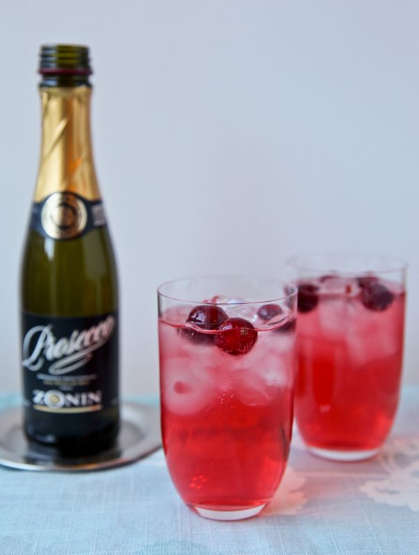 Dazzle your guests this Thanksgiving with a sparkling cocktail!   Cranberry vodka and cranberry juice is combined and topped with festive prosecco!