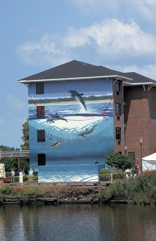 "WW 48 ""Coastal Dolphins""  The Coast Line Inn  503 Nutt Street  Wilmington, North Carolina  40 Feet Long x 30 Feet High  Dedicated August 30th, 1993  By Mayor Don Betz"