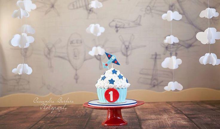 Airplane First Birthday Smash Cake Set with Vintage Airplane Backdrop.