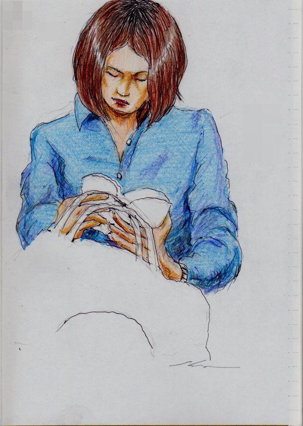 青いシャツのお姉さん(通勤電車でスケッチ)This is a woman of sketch wearing a blue shirt. It drew in a commuter train.