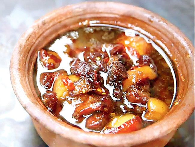 Tit Koh  Ingredients > 1 kg pork, with a little fat (cut into 1 inch cubes) > Jaggery to taste > 1 cup coconut water > 1 cup fish sauce > ½ cup honey > Red chillies > Salt to taste  Dish from (Pondicherry)