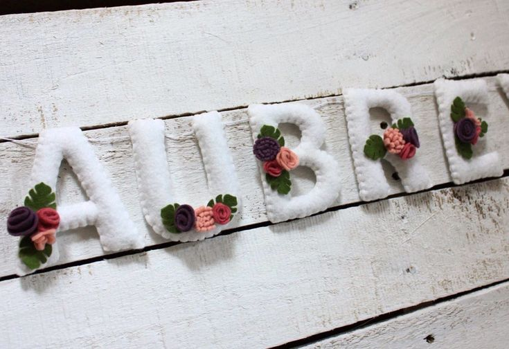 Felt name banner, nursery decor, felt letters, flower name banner, girl, floral nursery decor, flower baby shower banner, felt name by TheHoneyHiveWorkshop on Etsy https://www.etsy.com/ca/listing/568669306/felt-name-banner-nursery-decor-felt