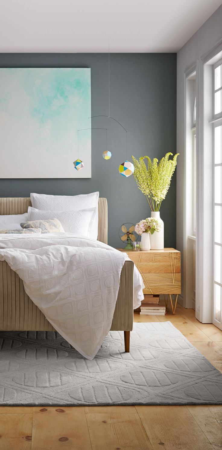 Neutral bedroom with grey accent wall, layered neutrals, mint turquoise  artwork - cute geometric mobile