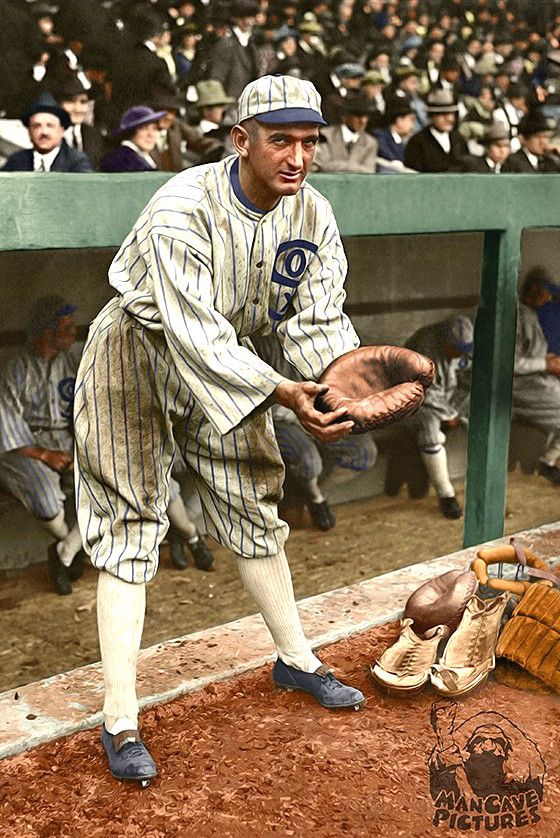 SHOELESS JOE: This is a 1919 photograph of Chicago White Sox baseball player Shoeless Joe Jackson in an unusual stance posing with a glove and catcher's equipment nearby. Jackson never played catcher. With the exception of 27 games at first base for Cleveland in 1915, he was always an outfielder.  [colorized version]