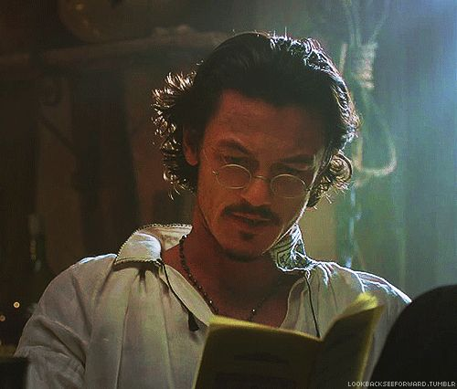 Luke Evans as Aramis in The Three Musketeers 2011. I'm watching it right now, and this scene always reminds me why I love this movie so much: Aramis reads. *sighs*