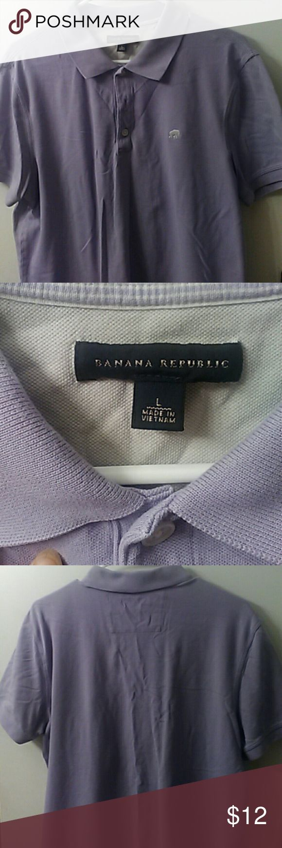 Mens Banana Republic polo Color is a soft pastel purple and has an elephant logo on the front. Condition is excellent and color still looks new. No tears or staining. Banana Republic Shirts Polos