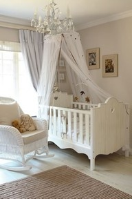 Beautiful baby room in White theme. I am so in love with that crib! I wonder how safe it is....