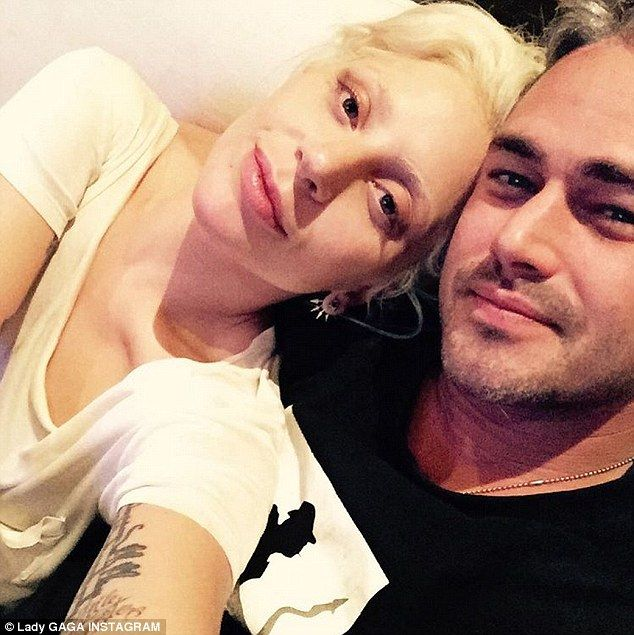 Meant to be: Lady Gaga cuddled up to fiance Taylor Kinney, 34