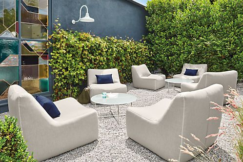 Lounge in comfort and style. The Maya outdoor chair's white zig-zag top stitching and oversized proportions catch your eye, but its comfort wins you over. A subtly u-shaped seat and back cradles you in comfort, while a marine-grade plywood frame, open-cell foam and Sunbrella® fabric deliver outdoor performance. This modern collection's armless design allows you to place chairs and chaises side by side to create sofas or sectionals, or pull them apart for solo lounging.