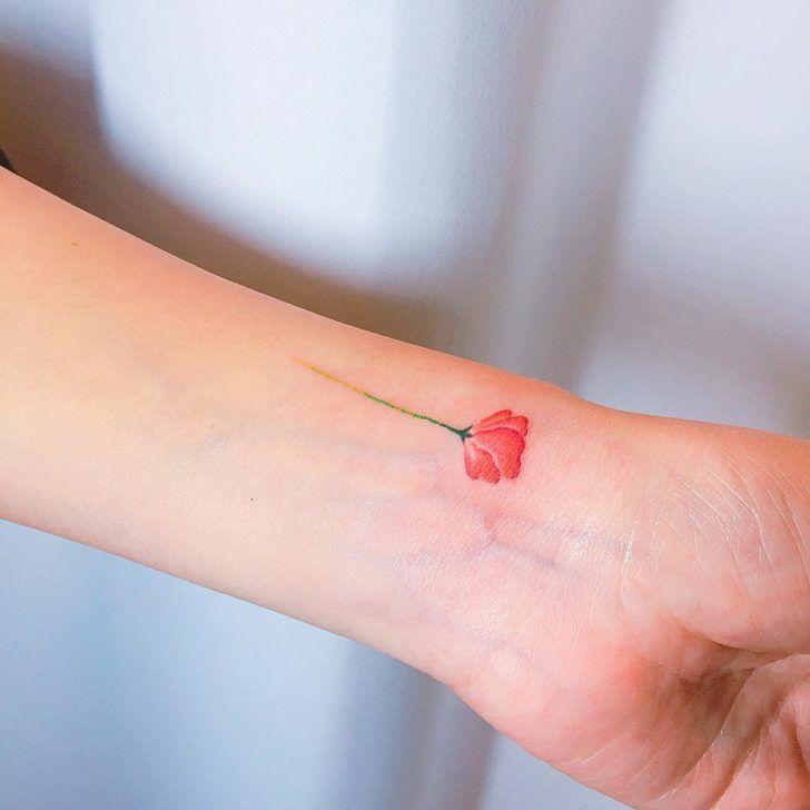 cute flower tattoo by bomiomi