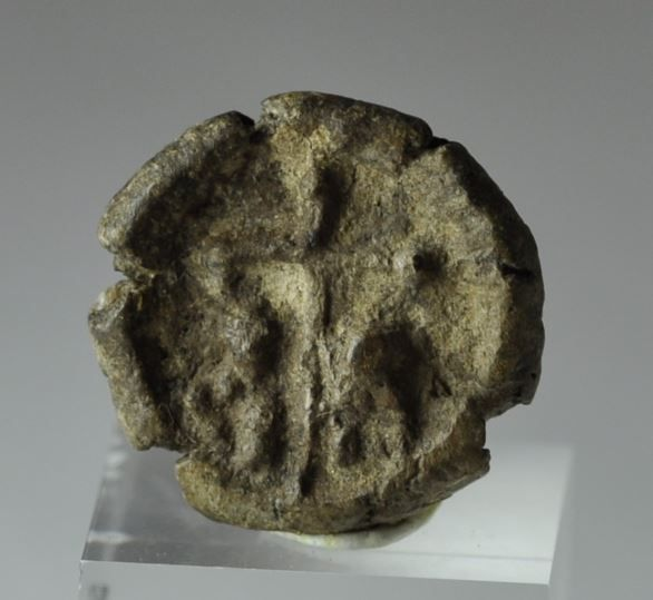 "True cross tokens were issued as souvenirs of the celebrations accompanying the return of the Cross to Jerusalem in 630 A.D. They are small clay or terra-cotta ""medallions"", made by pressing a lump of clay into a probably wooden mold. It is said that a piece of the wood of the Cross was burned and the ash mixed with the clay, hence the tokens, themselves, became miniature reliquaries, 1.9 cm diameter. Private collection"