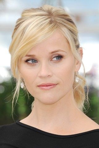 Side bangs. Very attractive and feminine hairstyle, yet not curly.  (Reese Witherspoon)