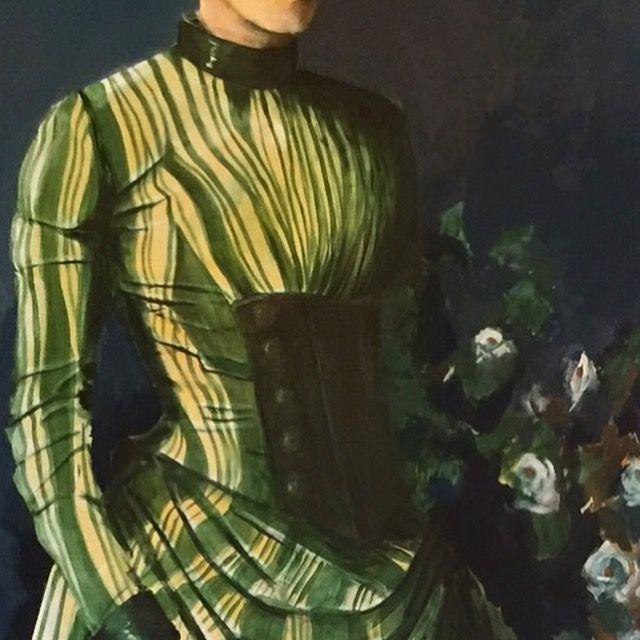 Art detail of a girl in a green silk dress