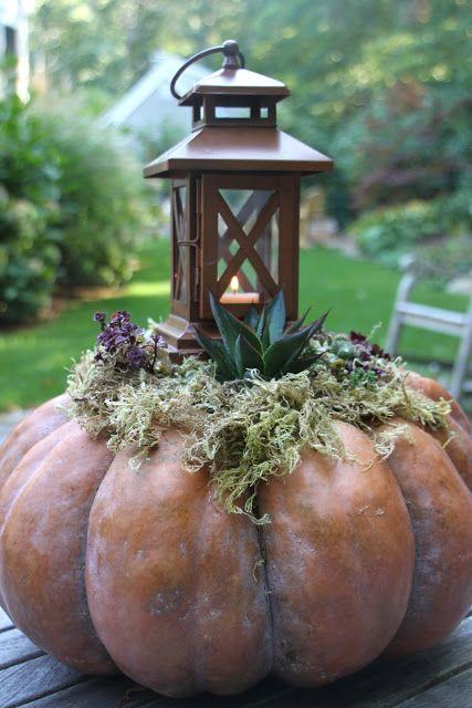 lantern on top of a pumpkin