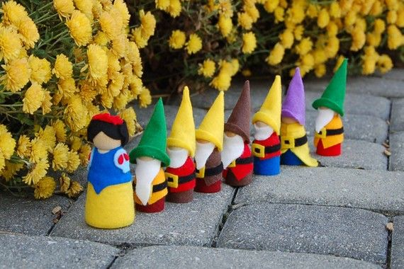 snow white and the seven dwarfs wooden doll set, but i wish they were garden gnomes.
