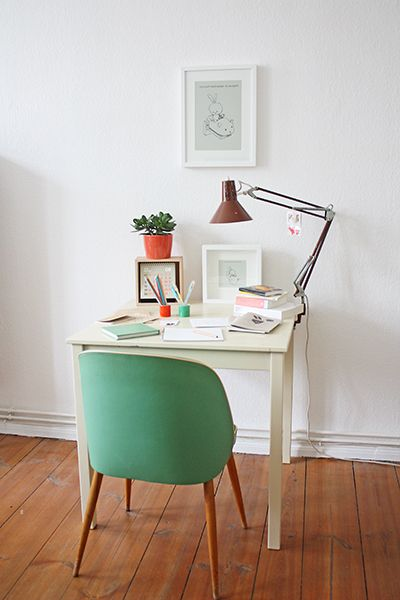 small modern work space with mint green chair & white desk
