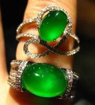 Two imperial green jadeite rings with diamonds