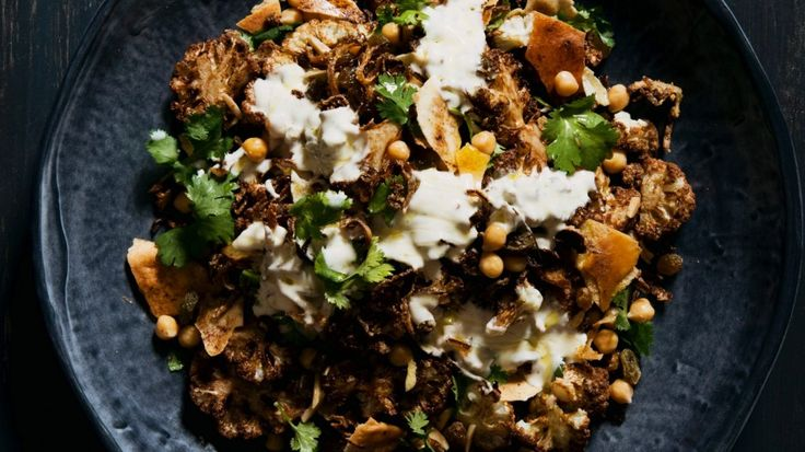 Cauliflower and chickpea salad with almonds, fried onion and sultanas.