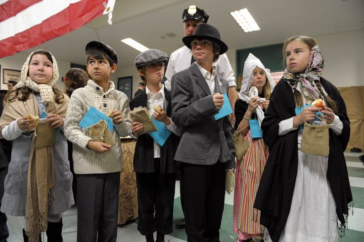 ALL DRESSED UP - Students wait in line for train tickets while participating in White Oak Elementary School's Ellis Island simulation in Westlake Village on Fri., March 1.  MC 136