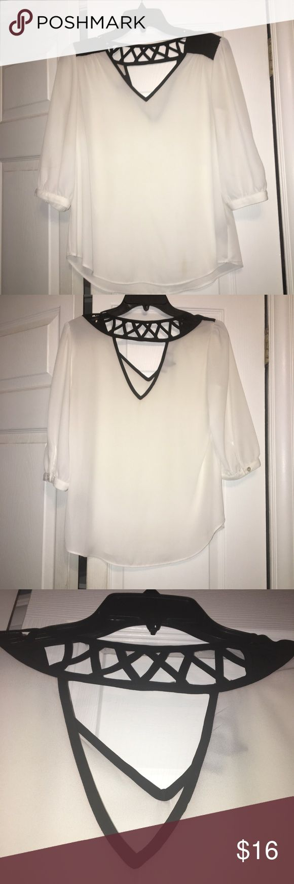 White dress blouse Black and white blouse. Sheer material, definitely need to wear white or nude underneath. Geometric cutout detailing on back. 3/4 sleeves, buttoned. 100% polyester BCX Tops Blouses