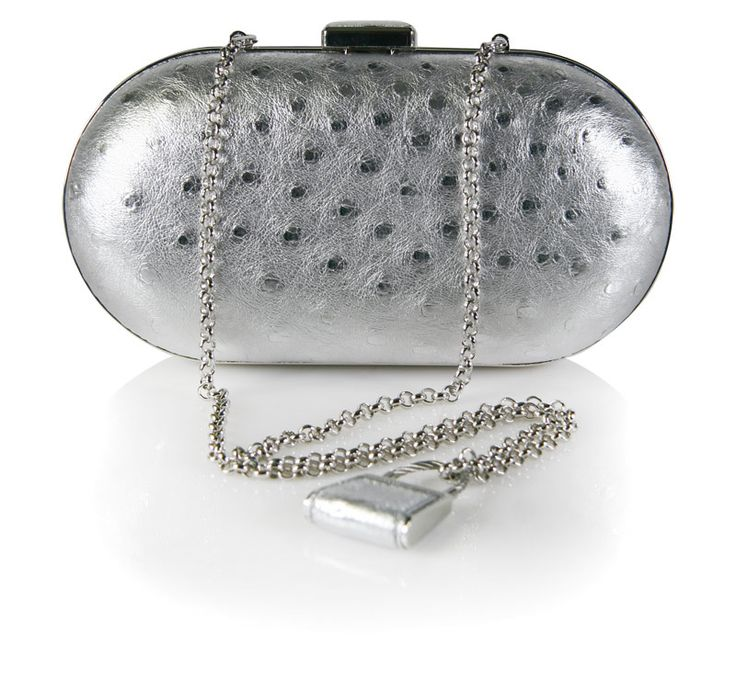 exclusively available through the Via La Moda Showroom. Genuine Ostrich leather clutch bag in silver