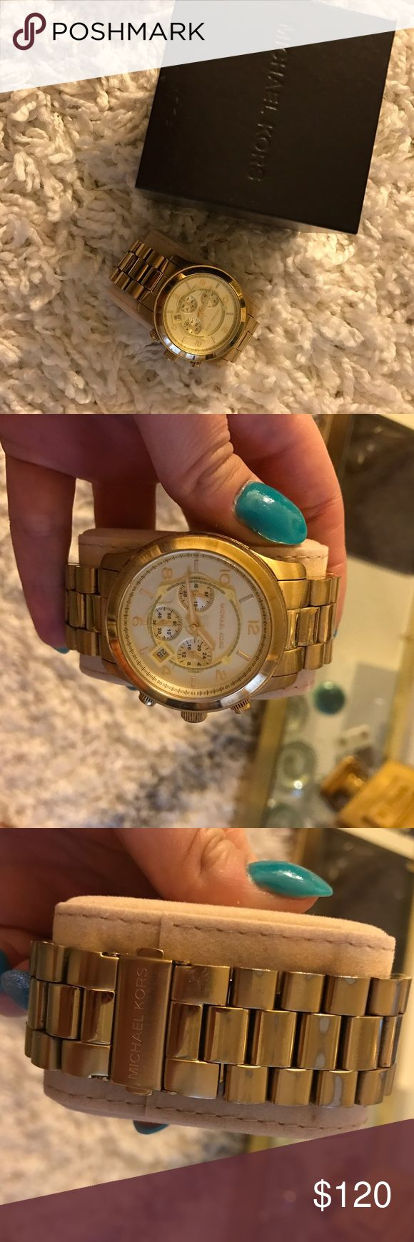 Michael kors gold oversized watch Good oversized watch from Michael kors. There is some wearing on the band, which would lay on the underside of the wrist. Comes with box and original links. Michael Kors Accessories Watches