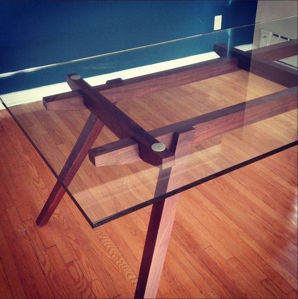 a beautiful modern wood and glass table with a mid century feel available for sale