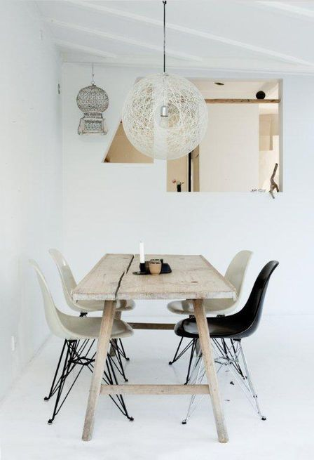 Here's the weathered wooden dining table where the family gathers for meals and conversation.  Photo by: Jonas Bjerre-Polsen
