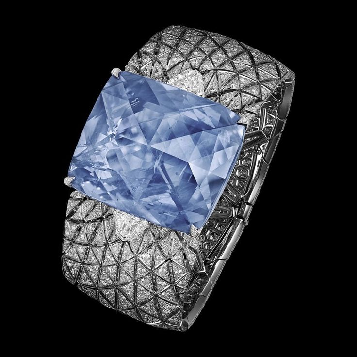 """CARTIER. """"Romanov"""" Bracelet - platinum, one 197.80-carat cushion-shaped rose-cut sapphire from Ceylon, two D IF modified shield step-cut diamonds totaling 2.50 carats and brilliant-cut diamonds. The sapphire can be replaced by a carved rock crystal motif. #Cartier #ÉtourdissantCartier #2015 #HauteJoaillerie #HighJewellery #FineJewelry #Sapphire #Diamond"""