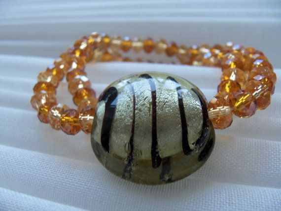 Tiger Shine Bracelet: made of beautiful glass beads and orange tones