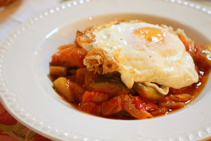 This delicious pisto recipe is Spain's version of ratatouille. Eggplant, zucchini, peppers, onions, garlic & tomato are perfectly stewed & served with eggs!