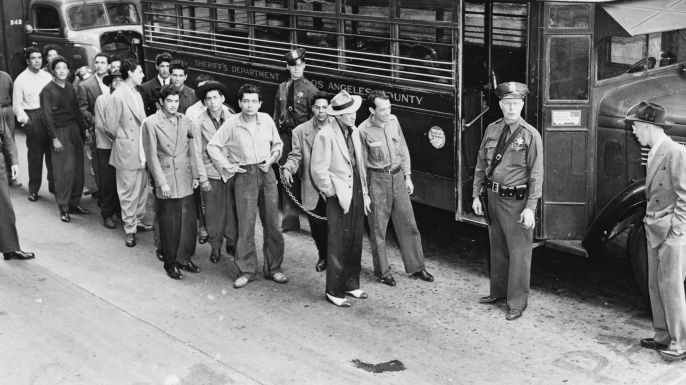 """1943's """"Zoot Suit Riots"""" take their name from the high-waisted wool trousers and baggy, long-tailed suit coats then worn by many Los Angeles..."""