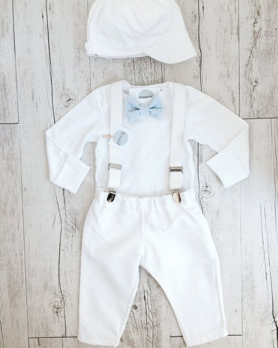 Traditional white with a vintage cool vibe  this baby boys suspenders, onesie, bow tie and pants outfit will stand out at any christening! Super comfortable means your baby will enjoy the special occasion even more.  The regular outfit comes with Long sleeved bodysuit (fastens at crotch), sewn in bowtie, white suspenders and matching white pants (trousers). The additional items of the cap and/or the shoes are available in the drop down menu. Bow tie options are (shown in the photo) Light ...