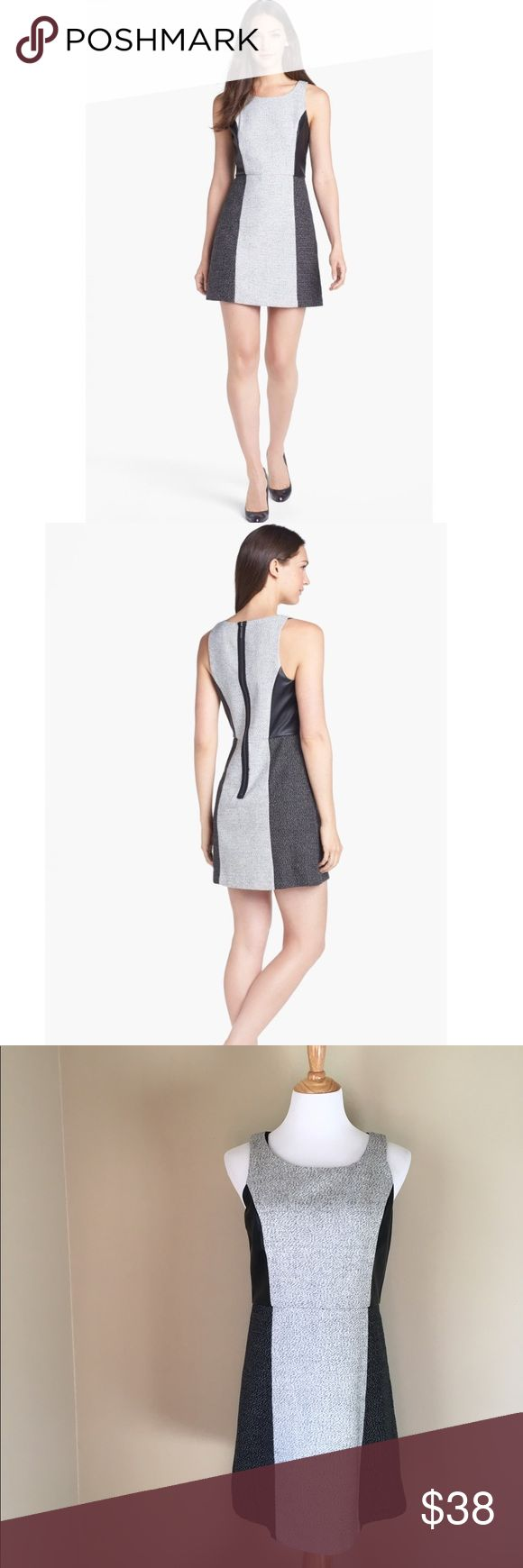 Kensie Colorblock Faux Leather Inset Tweed dress Modern faux leather enhances the color-blocked style of a tweed dress designed with figure-flattering seaming. A bold exposed zipper in back completes the contemporary look. Exposed back zip closure. Lined. Polyester/acrylic/rayon/nylon/wool; polyurethane; machine wash. Kensie Dresses Midi