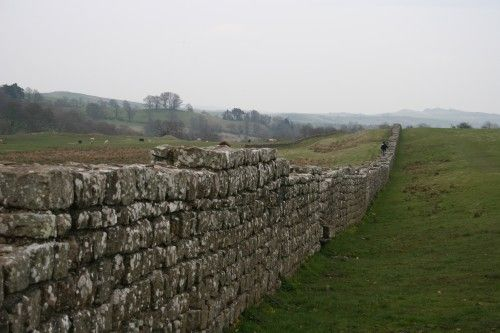 Hadrian's Wall, begun by the Emperor Hadrian, was built along the border of the Roman empire in Britain.  It dates to 122 C.E.