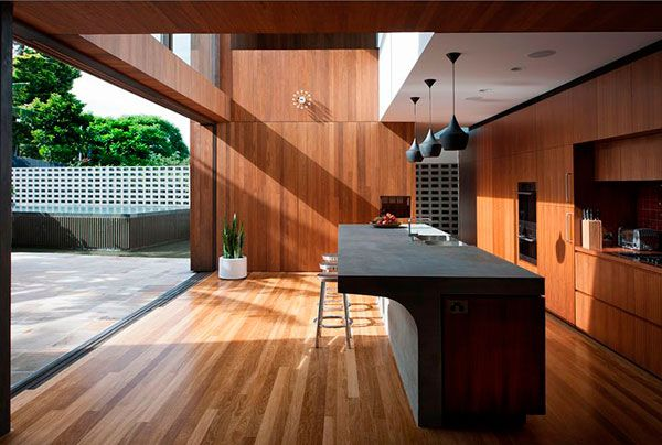 concrete kitchen counter + sunlight  don't love that much wood but with different cabinets it would be my dream kitchen!